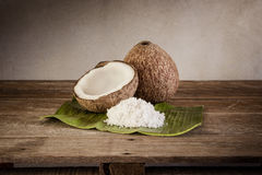 Coconuts and coconut flakes on banana leaf Royalty Free Stock Photography