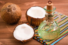 Coconuts and coconut oil in a bottle Stock Image
