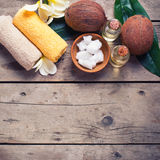 Coconuts,  coconut oil and towels on  vintage wooden background. Stock Photography