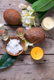 Coconuts and coconut oil on  vintage wooden background. Stock Photography