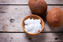 Coconuts and coconut oil on  vintage wooden background Royalty Free Stock Image