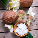 Coconuts and coconut oil on  vintage wooden background. Stock Photos
