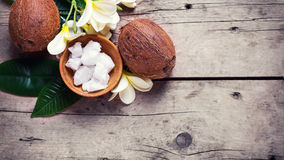 Coconuts,  coconut oil  on  vintage wooden background. Royalty Free Stock Photography