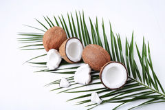 Coconuts. With green leaf on white wooden table Stock Photos