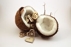 Coconuts with hearts. Two parts of coconuts with wooden hearts inside Royalty Free Stock Images
