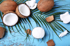 Coconuts. With leafs on blue wooden table Royalty Free Stock Image