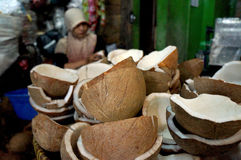 Coconuts. Merchants selling coconuts in a traditional market in the city of Solo, Central Java, Indonesia Royalty Free Stock Image