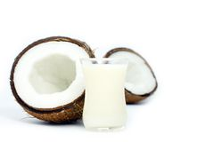 Coconuts and milk. Over white background Stock Photos