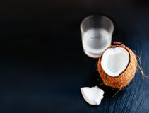 Coconuts with milk. Coconut with coconut milk in a glass Royalty Free Stock Photos