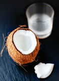Coconuts with milk. Coconut with coconut milk in a glass Royalty Free Stock Image