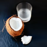 Coconuts with milk. Coconut with coconut milk in a glass on dark Stock Photography