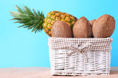 Coconuts and pineapple Stock Photo