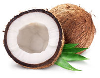 Coconuts and it's half with leaves. Royalty Free Stock Image