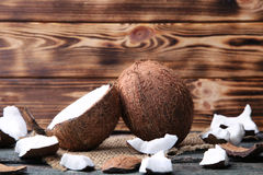 Coconuts. With sackcloth on wooden table Stock Images