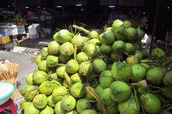 Coconuts for sale to travellers on a treet vendor in Vietnam Royalty Free Stock Images