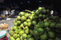Coconuts for sale to travellers on a treet vendor in Vietnam Royalty Free Stock Photo