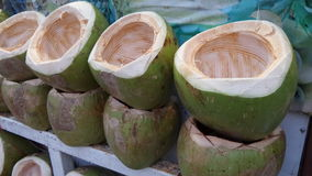 Coconuts shell. Ready to put coconut icecreme for cold juicy serve.  Every part of coconut can be used  - the husk is used to make cooking fire, the water is Stock Images