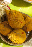 Coconuts with turmeric on upanayanam ceremony function. Royalty Free Stock Photography