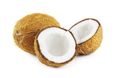 Coconuts on white. Group of coconuts with one broken open on a white background Royalty Free Stock Photo