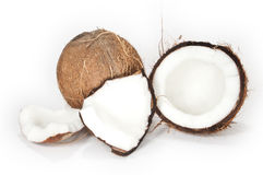 Coconuts on a white background. Two coconuts isolated on a white background. One of them is broken and filled with coconut milk royalty free stock photo