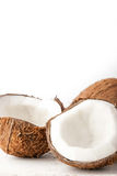 Coconuts  on the white background vertical. Coconuts  on the white table on the white background vertical Royalty Free Stock Photos