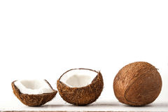 Coconuts  on the white table  horizontal Royalty Free Stock Photo