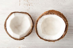 Coconuts  on the white table top view. Split coconut  on the white table top view Royalty Free Stock Image