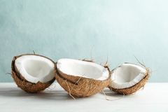 Coconuts on white wooden table royalty free stock images