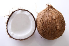 Coconuts - whole and halved Stock Photos