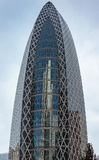 The Cocoon building reflects L-shaped skyscraper. Royalty Free Stock Photo