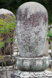 Cocoon-like rock decorates Buddhist cemetery. Stock Photo