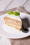 Cocos cake with banana, decorated mint stock image
