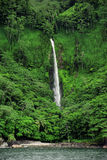 Cocos Island waterfall. A jungle waterfall on the coast of Cocos Island Costa Rica Royalty Free Stock Photography