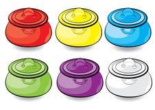 Cocotte en terre colorée de dessin animé Photos stock