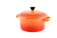 Cocotte en terre orange images stock