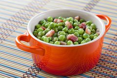 Cocotte with peas and bacon Stock Photo