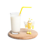 Coctail. Glass of milk on wooden plate, isolated on whitte Stock Photography