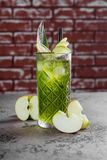 Coctail with apple and lime. stock photography