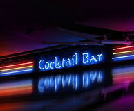 Coctail bar neon sign glowing. Colorful cocktail bar neon sign glowing on dark background stock photo