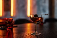 Coctail with Black Olive on the Stick. On the Table royalty free stock photography
