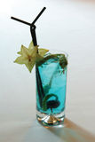Coctail blue. Coctail (vodka with liqueur) in the glass on the table Royalty Free Stock Image