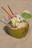 Coctail in cocnut. Fancy cocktail on the beach, flowers in coconuts Stock Images