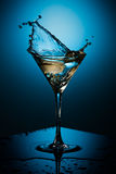 Coctail and ice plash. Ice plash, coctail and the blue background Stock Image
