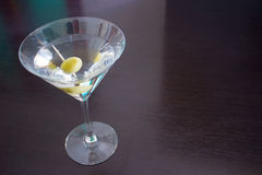 Coctail martini from above. A gorgeous martini cocktail served with green olives framed from above Stock Images