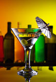 Coctail with olive and umbrella Royalty Free Stock Image