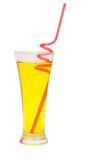 Coctail with red straw. Glass of energy drink with red spiral straw royalty free stock photography