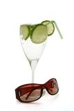 Coctail and sun-eye-glasses. On the white background stock photography