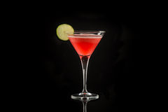Coctail. Vodka coctail with berry and lime Stock Image