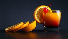 CoctailTequilasoluppgång och apelsin Arkivfoto
