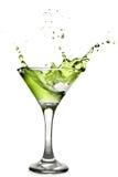 Coctel verde del alcohol con el chapoteo foto de archivo